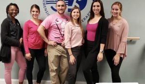 Jess with the 3DPT Haddon Township team, all wearing Pink for Breast Cancer Awareness month